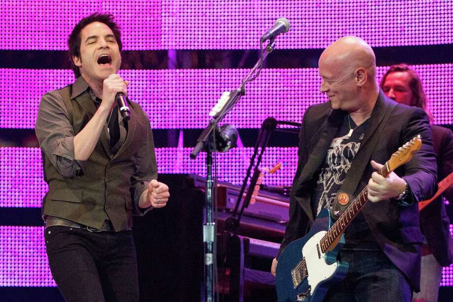 Patrick Monahan (left) and Jimmy Stafford of Train pull into the Whitewater Amphitheater on Sunday to promote the band's latest album. Photo: Smiley N. Pool, Houston Chronicle / © 2012  Houston Chronicle