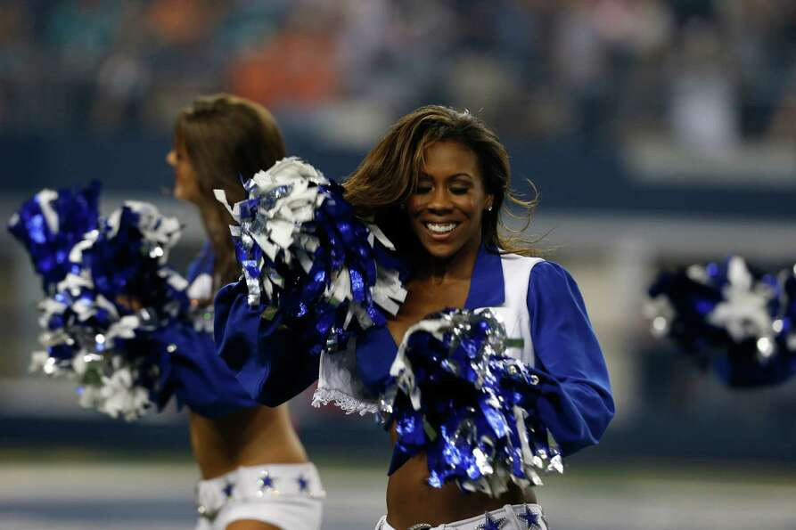 A member of the Dallas Cowboys cheerleaders performs during a preseason NFL football game against th