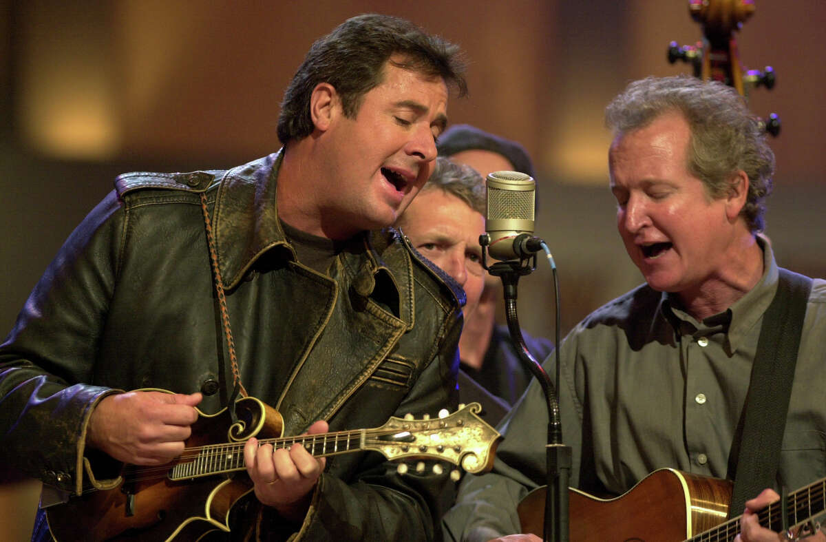 Vince Gill (left), performs with Jeff White at the Grand Ole Opry in 2006. Gill's newest role is a member of the Time Jumpers, a swing band, but he knows the value of songs that brought him country fame.