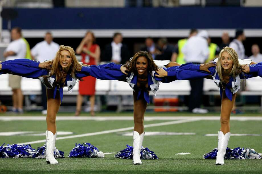 Members of the Dallas Cowboys cheerleaders perform before a preseason NFL football game against the Miami Dolphins Wednesday, Aug. 29, 2012, in Arlington, Texas. (AP Photo/Sharon Ellman) Photo: Sharon Ellman, Associated Press / FR170032 AP