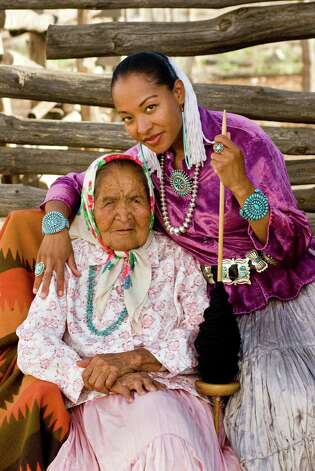 "Radmilla Cody, Miss Navajo 1997, poses with her grandmother. The image is part of ""IndiVisible: African-Native American Lives in the Americas"" at the Institute of Texan Cultures. Photo: Courtesy John Running"