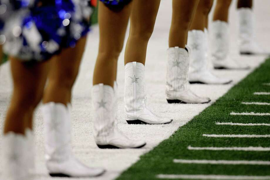 A Dallas Cowboys cheerleader line up during the second half of a preseason NFL football game between the Miami Dolphins and Dallas Cowboys Wednesday, Aug. 29, 2012, in Arlington, Texas. (AP Photo/LM Otero) Photo: LM Otero, Associated Press / AP