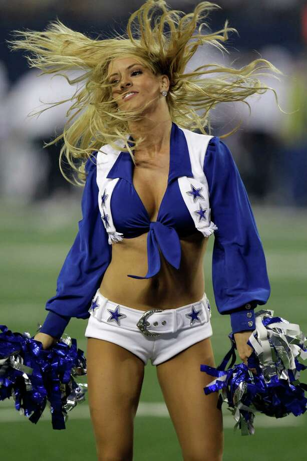 A member of the Dallas Cowboys cheerleaders performs in the first half of a preseason NFL football game against the Miami Dolphins Wednesday, Aug. 29, 2012, in Arlington, Texas. (AP Photo/LM Otero) Photo: LM Otero, Associated Press / AP
