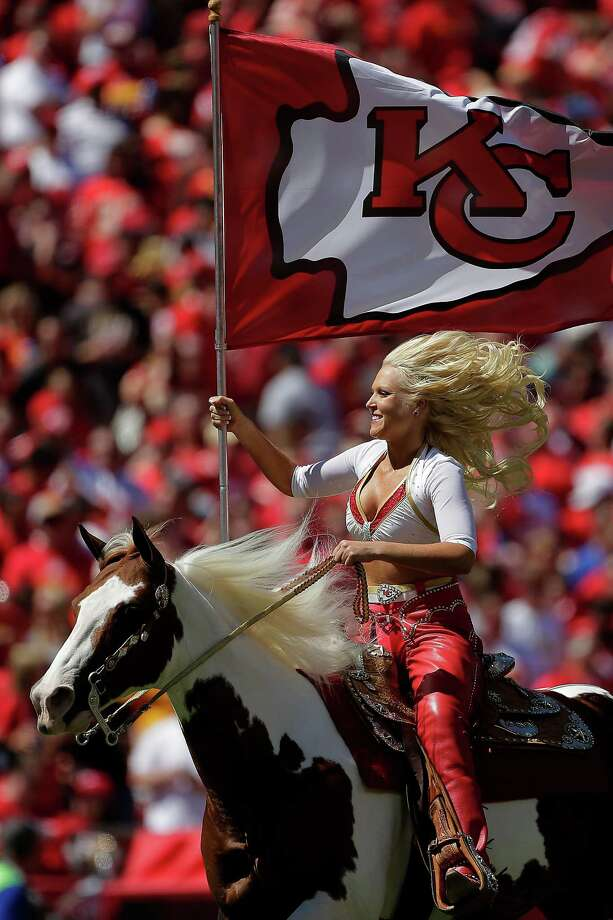 A Kansas City Chiefs Cheerleader rides Chiefs' mascot Warpaint during the first half of an NFL football game against the Atlanta Falcons Sunday, Sept. 9, 2012, in Kansas City, Mo. (AP Photo/Charlie Riedel) Photo: Charlie Riedel, Associated Press / AP