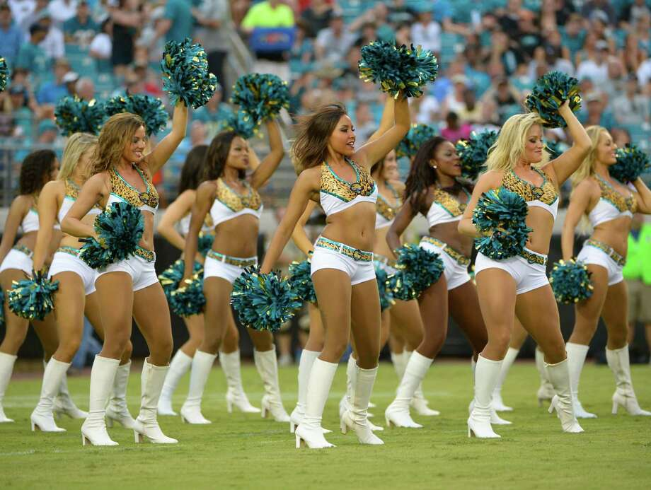 Jacksonville Jaguars cheerleaders perform during the first half of an NFL preseason football game against the Atlanta Falcons, Thursday, Aug. 30, 2012, in Jacksonville, Fla. Photo: AP