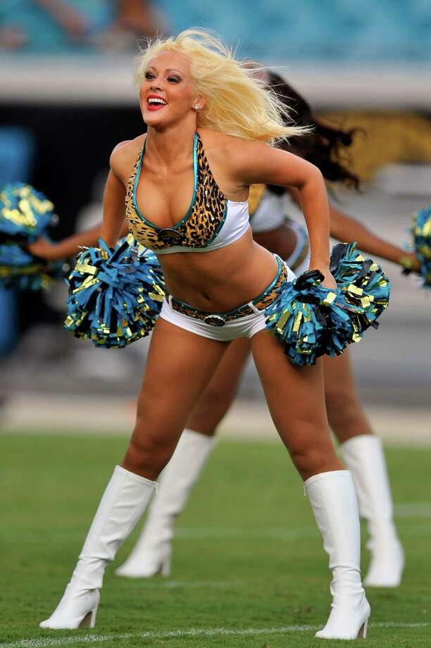 A member of the Jacksonville Jaguars Roar Cheerleaders performs at the end of the first half of an NFL preseason football game against the Atlanta Falcons, Thursday, Aug. 30, 2012, in Jacksonville, Fla. (AP Photo/Stephen Morton) Photo: Stephen Morton, Associated Press / FR56856 AP