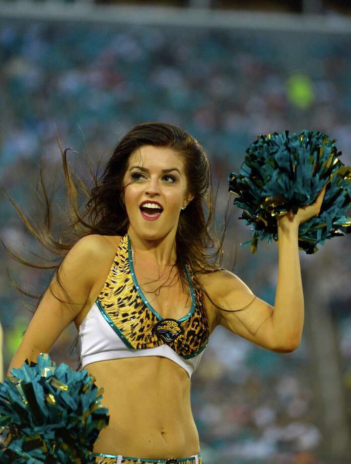 A Jacksonville Jaguars cheerleader performs during the first half of an NFL preseason football game against the Atlanta Falcons, Thursday, Aug. 30, 2012, in Jacksonville, Fla. (AP Photo/Phelan M. Ebenhack) Photo: Phelan M. Ebenhack, Associated Press / FR121174 AP