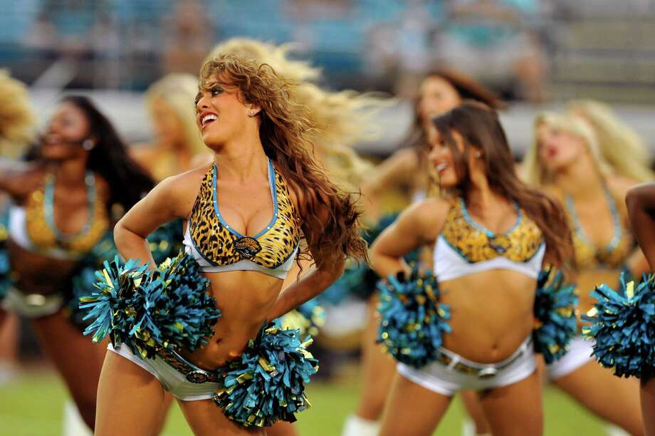 Members of the Jacksonville Jaguars Roar Cheerleaders performs at the end of the first half of an NFL preseason football game against the Atlanta Falcons, Thursday, Aug. 30, 2012, in Jacksonville, Fla. (AP Photo/Stephen Morton) Photo: Stephen Morton, Associated Press / FR56856 AP