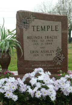 The grave of Belinda Tracie and Erin Ashley Temple where Kenneth and Maureen Temple, parents of David Temple, and his brothers, Darren and Kevin give a graveside statement.  Katy Magnolia Cemetery on Franz Road in Katy.  February 20, 2005. Photo: Gary Fountain, For The Chronicle / Freelance