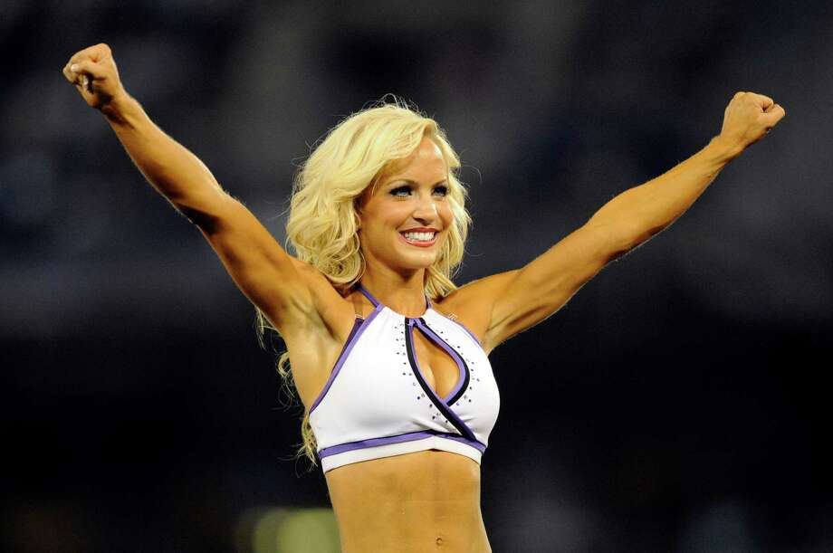 A Baltimore Ravens cheerleader performs in the first half of an NFL preseason football game against the Jacksonville Jaguars in Baltimore, Thursday, Aug. 23, 2012. (AP Photo/Nick Wass) Photo: Nick Wass, Associated Press / FR67404 AP