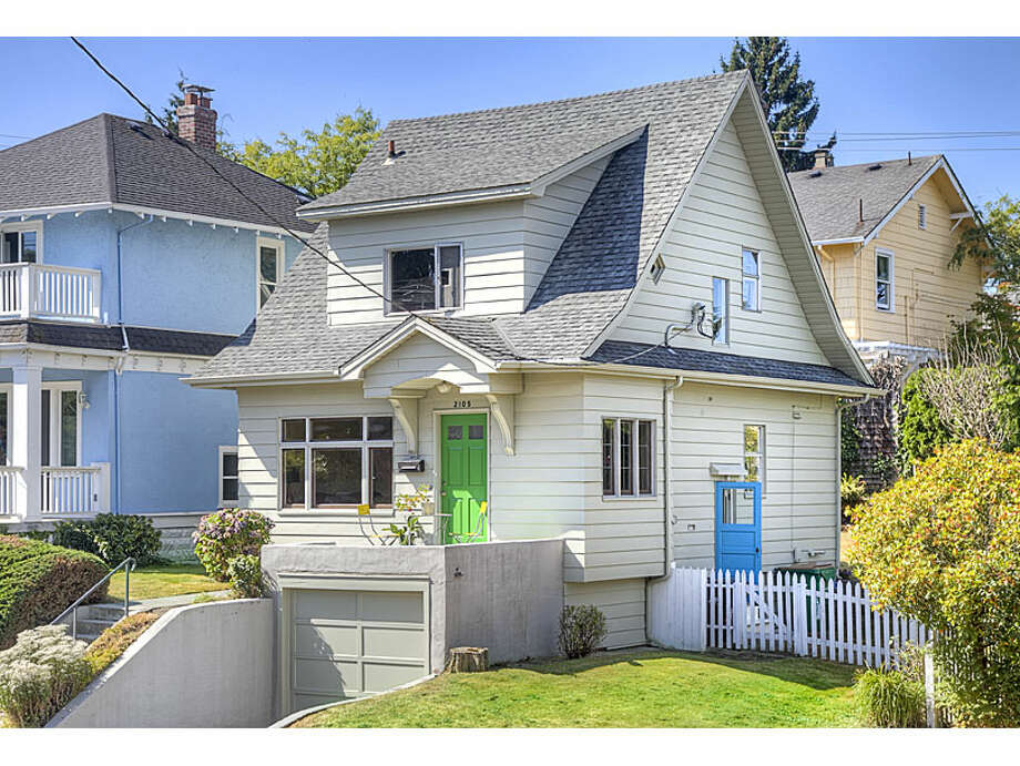 In Queen Anne, $600,000 is a reasonable price for house. Here are four in the esteemed Seattle neighborhood for around that amount, starting with the lowest-priced house, 2105 3rd Ave. W., which is listed for $599,000. The 1,700-square-foot house, built in 1906, has three bedrooms, 1.5 bathrooms, built-in shelves, arched passages, crown moldings and French doors on a 3,600-square-foot lot. Photo: Gregory White, Courtesy Diane Lancaster/Windermere Real Estate / (C) 2012 Gregory White