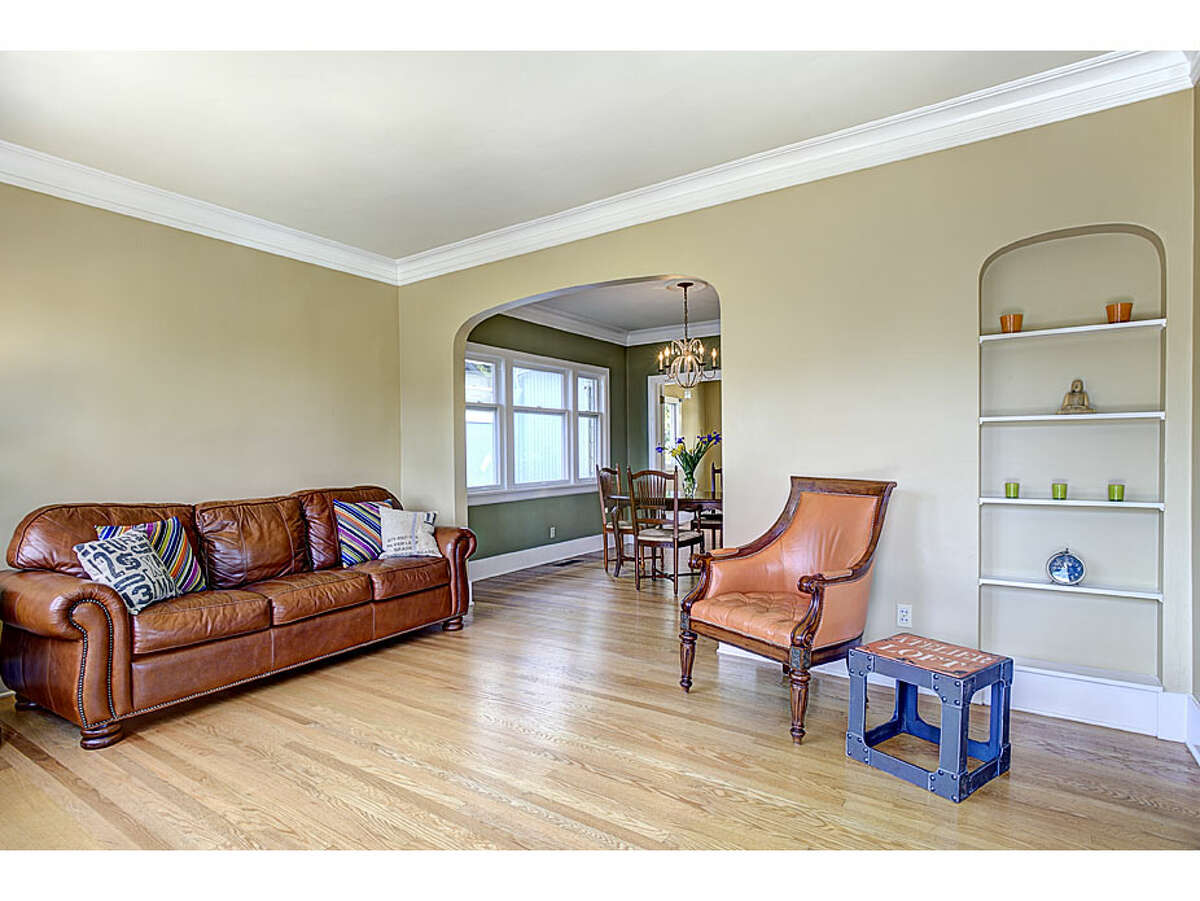 Living room of 2105 3rd Ave. W. The 1,700-square-foot house, built in 1906, has three bedrooms, 1.5 bathrooms, built-in shelves, arched passages, crown moldings and French doors on a 3,600-square-foot lot. It's is listed for $599,000.