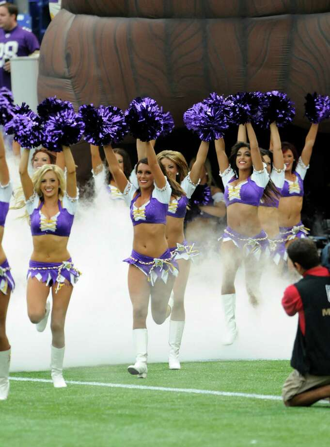 Minnesota Twins cheerleaders come onto the field before the first half of an NFL football game against the Jacksonville Jaguars Sunday, Sept. 9, 2012, in Minneapolis. (AP Photo/Genevieve Ross) Photo: Genevieve Ross, Associated Press / FR170496 AP