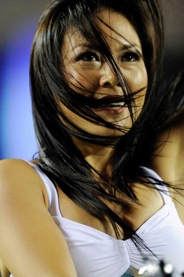A Philadelphia Eagles cheerleader performs in the second half of a preseason NFL football game against the New York Jets, Thursday, Aug. 30, 2012, in Philadelphia. (AP Photo/Michael Perez) Photo: Michael Perez, Associated Press / FR168006 AP