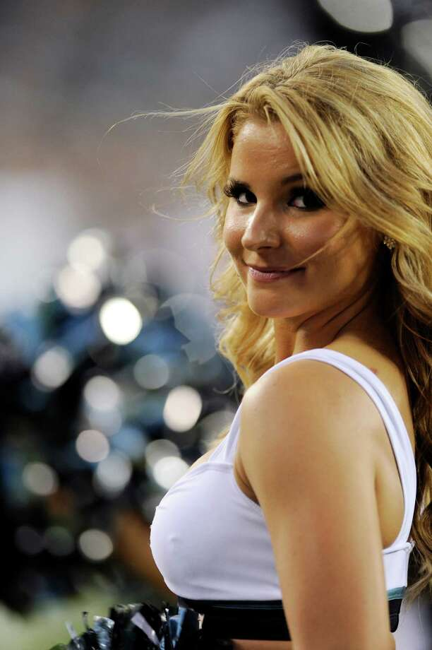 A Philadelphia Eagles cheerleader smile for the camera in the first half of a preseason NFL football game against the New York Jets, Thursday, Aug. 30, 2012, in Philadelphia. (AP Photo/Michael Perez) Photo: Michael Perez, Associated Press / FR168006 AP