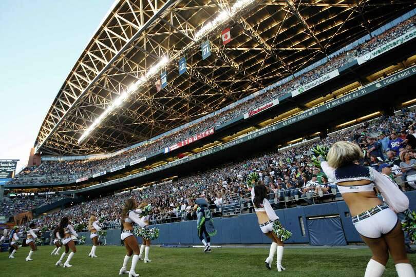Seattle Seahawks cheerleaders perform in front of a hometown crowd during the first half of a presea