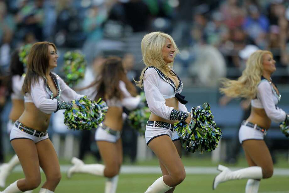 Seattle Seahawks cheerleaders during the first half of a preseason NFL football game against the Oakland Raiders Thursday, Aug. 30, 2012 in Seattle. (AP Photo/Stephen Brashear) Photo: STEPHEN BRASHEAR, Associated Press / FR159797 AP