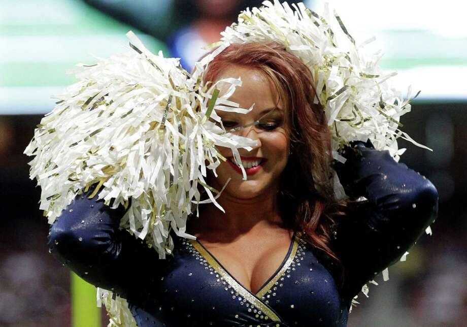 A St. Louis Rams cheerleader performs during the second quarter of a preseason NFL football game between the St. Louis Rams and the Baltimore Ravens Thursday, Aug. 30, 2012, in St. Louis. (AP Photo/Seth Perlman) Photo: Seth Perlman, Associated Press / AP