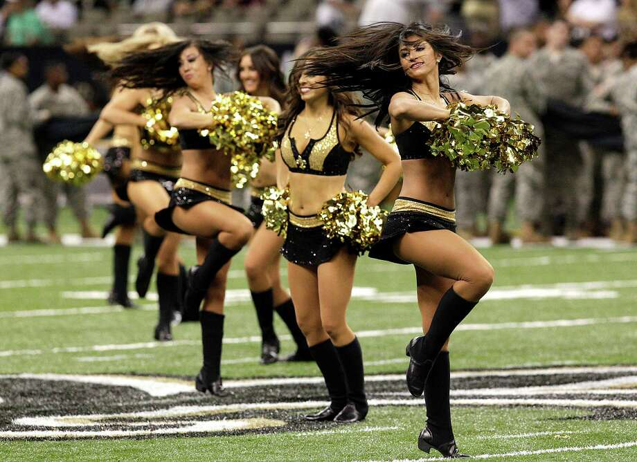 New Orleans Saints cheerleaders perform during an NFL football game against the Washington Redskins at the Mercedes-Benz Superdome in New Orleans, Sunday, Sept. 9, 2012.  (AP Photo/Matthew Hinton) Photo: Matthew Hinton, Associated Press / FR170690 AP