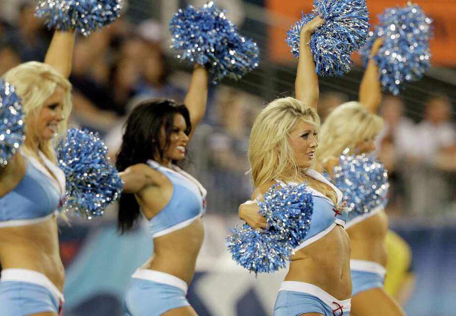 Tennessee Titans cheerleaders perform in the third quarter of an NFL football preseason game against the New Orleans Saints on Thursday, Aug. 30, 2012, in Nashville, Tenn. (AP Photo/Wade Payne) Photo: Wade Payne, Associated Press / FR23601 AP