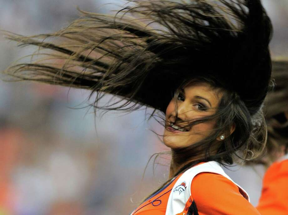 A Denver Broncos cheerleader performs, in the first half of an NFL football preseason game against the Seattle Seahawks, Saturday, Aug. 18, 2012, in Denver. (AP Photo/Jack Dempsey) Photo: Jack Dempsey, Associated Press / FR42408-AP