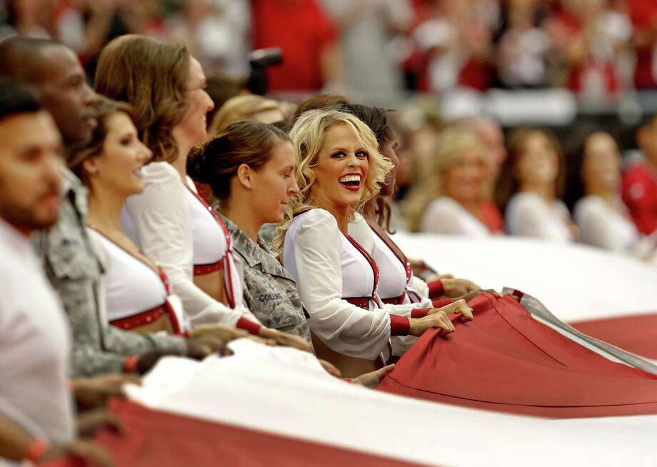 The Arizona Cardinals cheerleaders hold the flag during the national anthem prior to an NFL football game against the Seattle Seahawks, Sunday, Sept. 9, 2012,in Glendale, Ariz. (AP Photo/Ross D. Franklin) Photo: Ross D. Franklin, Associated Press / AP