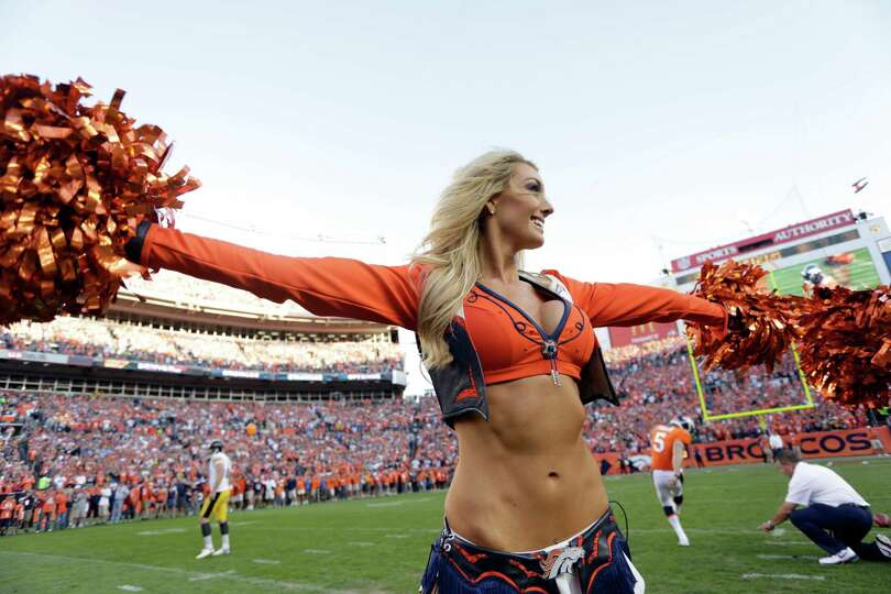 A Denver Broncos cheerleader performs before the start of an NFL football game between the Denver Br