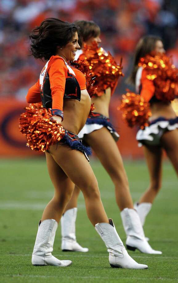 Members of the Denver Broncos cheerleaders perform during the first quarter of an NFL football game against the Pittsburgh Steelers , Sunday, Sept. 9, 2012 in Denver. (AP Photo/David Zalubowski) Photo: David Zalubowski, Associated Press / AP
