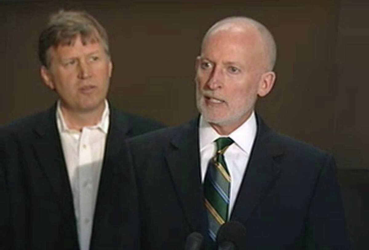 Seattle City Council member Tim Burgess speaks alongside council member Mike O'Brien during a press conference announcing an arena deal between investors and the City of Seattle that may bring back an NBA basketball team to Seattle.