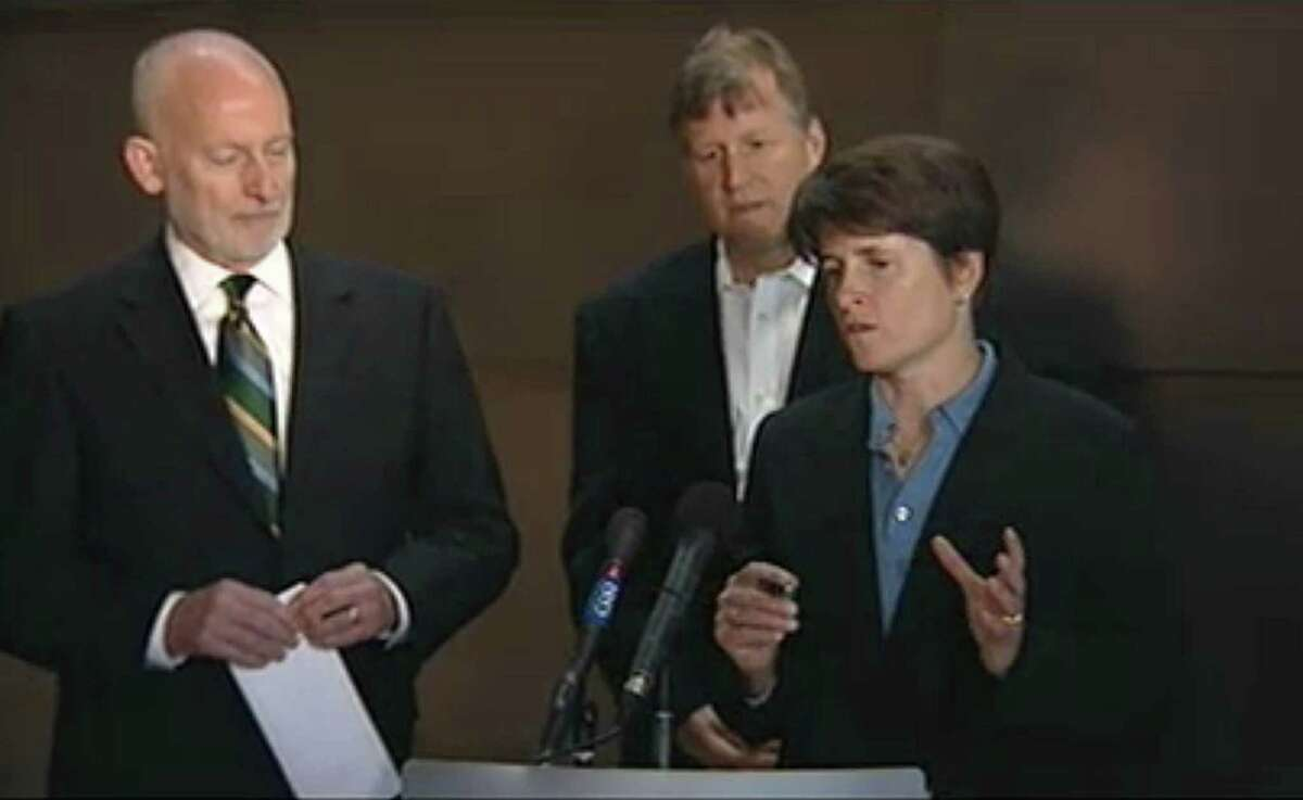 Seattle City Council member Sally Clark speaks alongside fellow council members Tim Burgess, left, and Mike O'Brien during a press conference announcing an arena deal between investors and the City of Seattle that may bring back an NBA basketball team to Seattle.