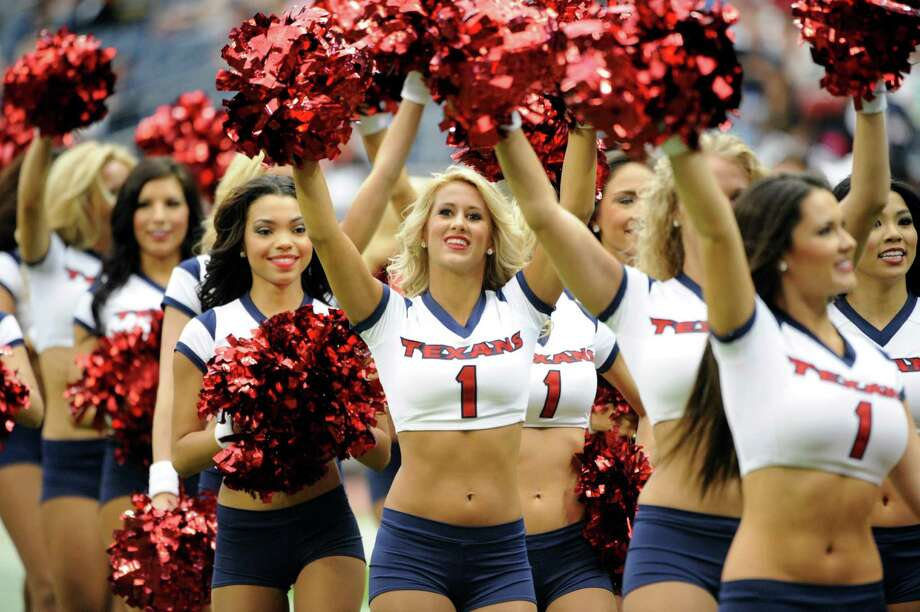 Houston Texans cheerleaders take the field before an NFL preseason football game against the Minnesota Vikings, Thursday, Aug. 30, 2012, in Houston. (AP Photo/Dave Einsel) Photo: Dave Einsel, Associated Press / FR43584 AP