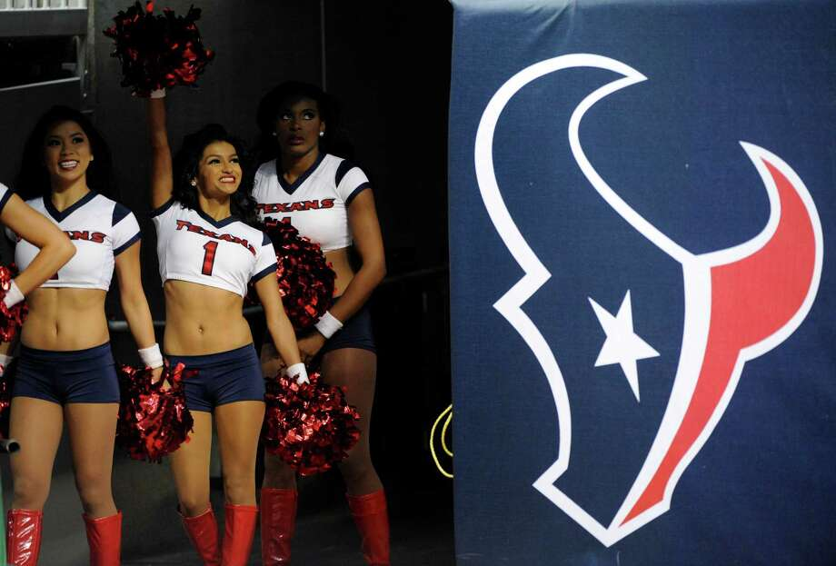 Houston Texans cheerleaders prepare to take the field before an NFL preseason football game against the Minnesota Vikings, Thursday, Aug. 30, 2012, in Houston. (AP Photo/Dave Einsel) Photo: Dave Einsel, Associated Press / FR43584 AP