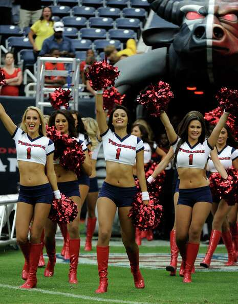 Houston Texans cheerleaders enter the field for an NFL preseason football game against the Minnesota