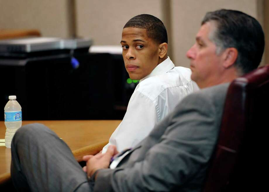 Testimony began Tuesday in Labyron Jaffar Warren's capital murder trial in Judge John Stevens Criminal District courtroom. Warren, left, 18, is one of four suspects charged in the 2010 robbery and slaying of Van's Grocery clerk Dang Minh Nguyen, a Lamar University nursing student. She was shot in the head during a robbery while working at the Avenue A store on Aug. 1, 2010. Prosecutors allege Warren is the gunman. He was 16 at the time of the offense and was certified to stand trial as an adult.  Dave Ryan/The Enterprise Photo: Dave Ryan