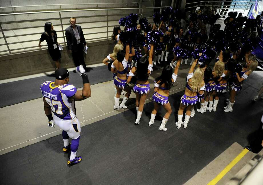 MINNEAPOLIS, MN - SEPTEMBER 09: Everson Griffen #97 of the Minnesota Vikings dances along with the cheerleaders in the tunnel before the season opener on September 9, 2012 at Mall of America Field at the Hubert H. Humphrey Metrodome in Minneapolis, Minnesota. Photo: Hannah Foslien, Getty Images / 2012 Getty Images