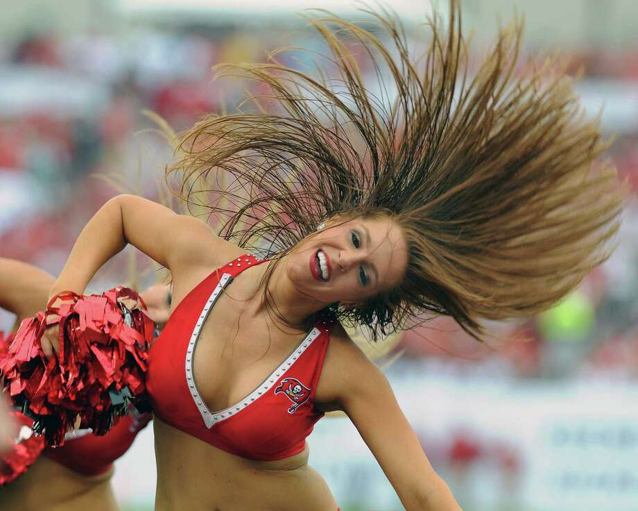 TAMPA, FL - SEPTEMBER 9:  A cheerleader of the Tampa Bay Buccaneers dances during play against the Carolina Panthers at Raymond James Stadium September 9, 2012 in Tampa, Florida. Photo: Al Messerschmidt, Getty Images / 2012 Getty Images