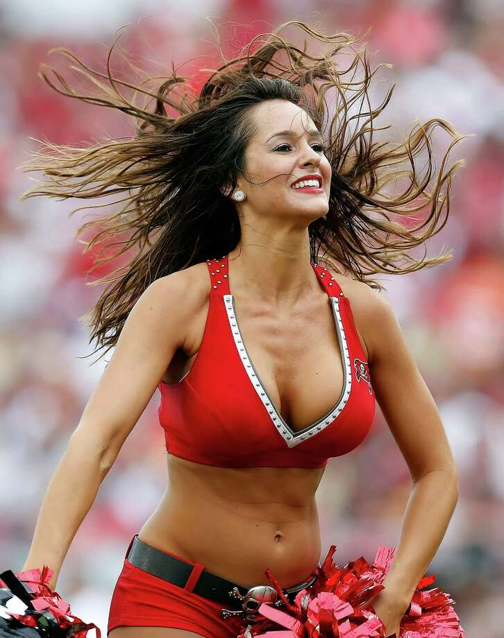 TAMPA, FL - SEPTEMBER 09:  A cheerleader of the Tampa Bay Buccaneers performs during the game against the Carolina Panthers at Raymond James Stadium on September 9, 2012 in Tampa, Florida. Photo: J. Meric, Getty Images / 2012 Getty Images