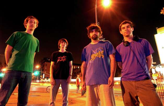 Animal Collective, from left, Josh Dibb, Noah Lennox, Brian Weitz and Dave Portner, creates layers of sound to be uncovered with repeat listens. Photo: Associated Press / AP2007