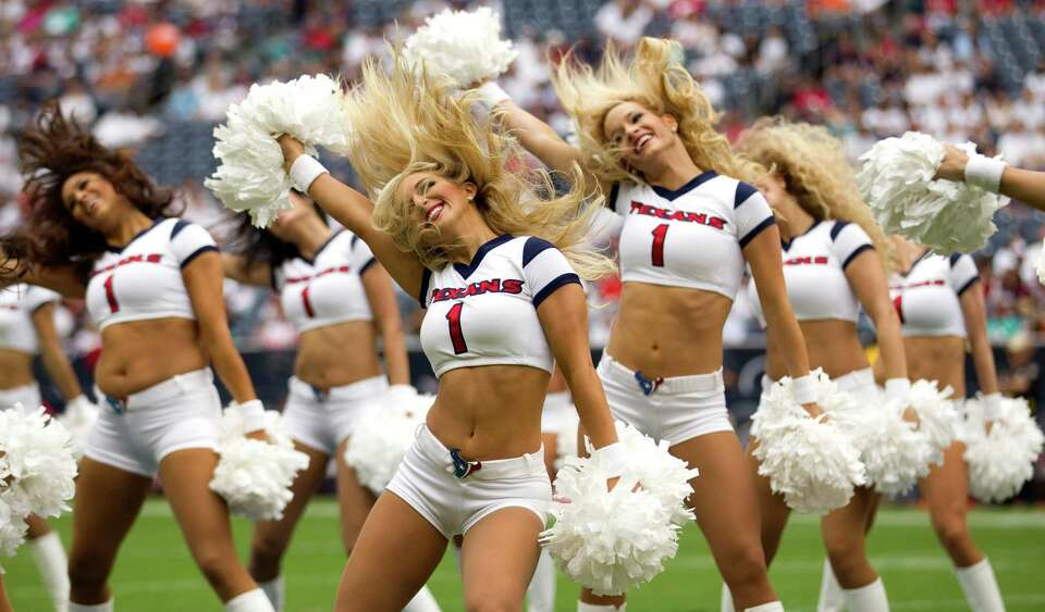 Houston Texans cheerleaders perform a routine before the Texans season opener against the Miami Dolp