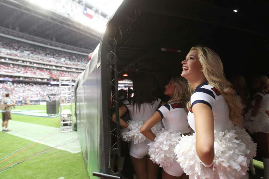 A Houston Texans cheerleader looks out over the stadium before taking the field before the season opener against the Miami Dolphins  at Reliant Stadium, Sunday, Sept. 9, 2012, in Houston. Photo: Karen Warren, Houston Chronicle / © 2012  Houston Chronicle