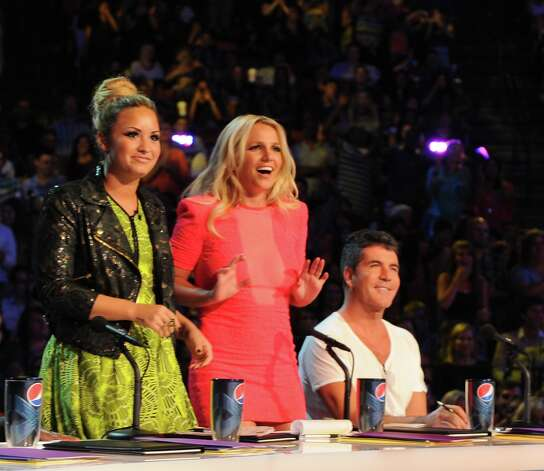 "Demi Lovato, from left, Britney Spears and Simon Cowell judge at ""X Factor"" auditions in Austin."