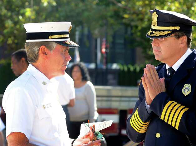 Fire Chief Brian Rooney and Police Chief Joseph L. Gaudett at a ceremony to mark the 11th anniversary of the terrorist attacks on Sept. 11, 2001 with a brief speaking program at the Margaret E. Morton Government Center in Bridgeport, Conn. on Tuesday, Sept. 11, 2012. Photo: Cathy Zuraw / Connecticut Post