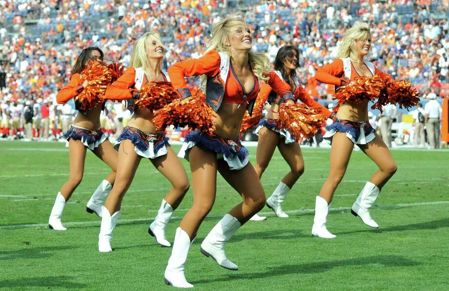 Denver Broncos cheerleaders perform during the second half of an NFL preseason football game against the San Francisco 49ers in Denver, Sunday, Aug. 26, 2012. (AP Photo/Jack Dempsey) Photo: Jack Dempsey, Associated Press / FR42408 AP
