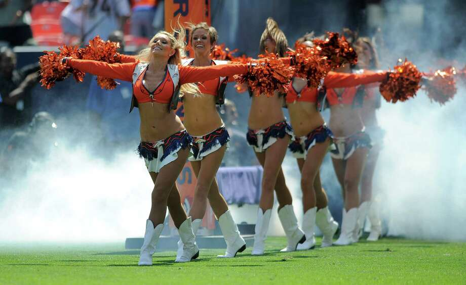 Denver Broncos cheerleaders perform before an NFL preseason football game between the San Francisco 49ers and the Denver Broncos in Denver, Sunday, Aug. 26, 2012. (AP Photo/Jack Dempsey) Photo: Jack Dempsey, Associated Press / FR42408 AP