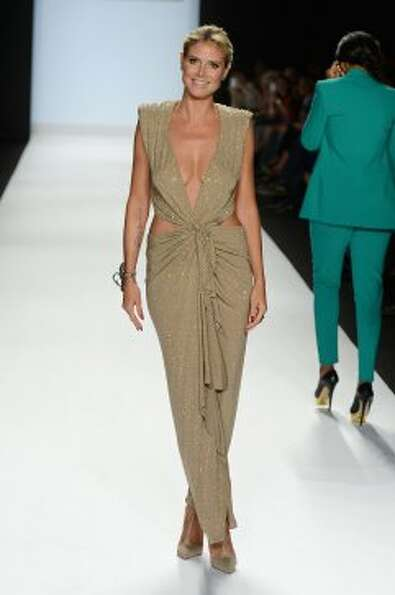 Model Heidi Klum walks the runway at the Project Runway Spring 2013 show during Mercedes-Benz Fashio