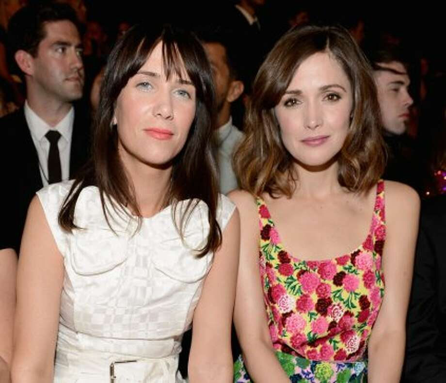 Kristen Wiig (L) and Rose Byrne attend the Marc Jacobs Spring 2013 show during Mercedes-Benz Fashion Week.  (Dimitrios Kambouris / 2012 Getty Images)