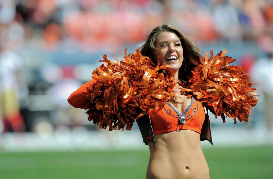 A Denver Broncos cheerleader performs during the first half of an NFL preseason football game betwee