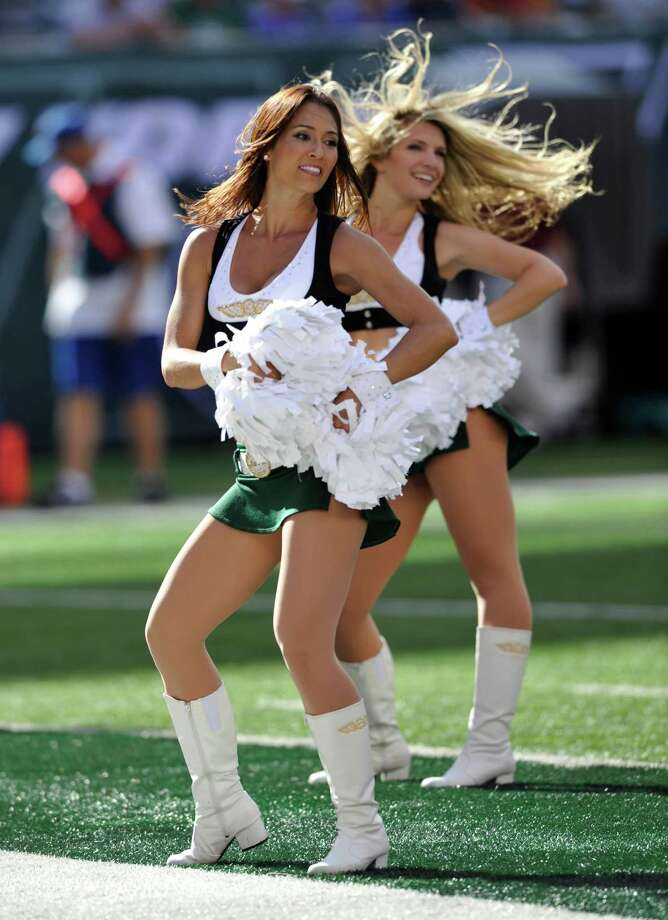 New York Jets cheerleaders perform during an NFL football game against the Buffalo Bills Sunday, Sept. 9, 2012, in East Rutherford, N.J. The Jets defeated the Bills 48-28. (AP Photo/Bill Kostroun) Photo: Bill Kostroun, Associated Press / FR51951 AP