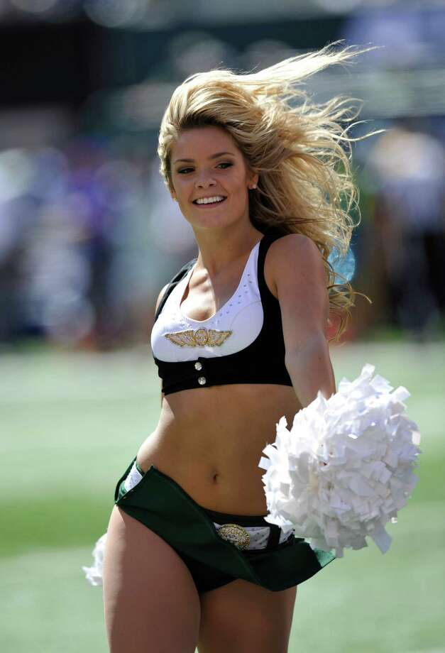 A New York Jets cheerleader during the first half of an NFL football game between the New York Jets and the Buffalo Bills at MetLife Stadium Sunday, Sept. 9, 2012, in East Rutherford, N.J. (AP Photo/Bill Kostroun) Photo: Bill Kostroun, Associated Press / FR51951 AP