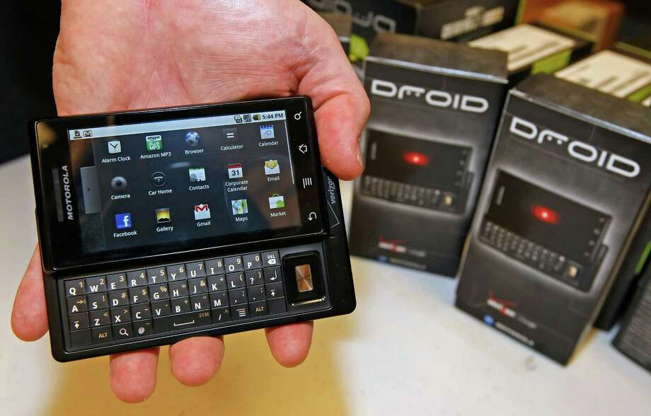 "Motorola rolled out its first Droid Android smartphone in 2009, touting it as having and doing what the iPhone didn't and couldn't, including a ""real keyboard."" As it turned out, most people weren't fussed about having a real keyboard. Photo: George Frey, Getty Images / 2009 Getty Images"